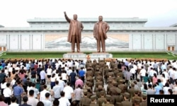 People gather to mark the occasion of the 23rd anniversary of the death of the country's founding father Kim Il Sung in this photo released by North Korea's Korean Central News Agency (KCNA) in Pyongyang July 8, 2017