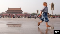 A boy runs on Tiananmen Square in Beijing on June 3, 2012, on the eve of the 23rd anniversary of China's brutal crackdown on democracy protests.