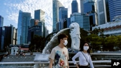 Singapore has been praised for its efforts to limit the spread of the new coronavirus. The city-state has had few cases of COVID-19. But measures that work in rich Singapore might not work in other places.