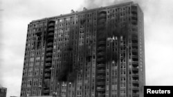 A building burns after being shelled in the Pofalici district in Sarajevo April 1992. Serbia may send Ratko Mladic to face genocide charges in The Hague within four days, a justice official said May 30, 2011, despite riots by nationalists angry at the Bos