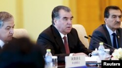 FILE - Tajikistan President Imomali Rahmon, center, attends a meeting with Chinese President Xi Jinping (unseen) at the Diaoyutai State Guesthouse in Beijing, China, Sept. 2, 2015.