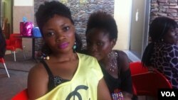 Masia Haliki, 23, left and Vida Sunkari, 26, right, at the food court of the Accra Mall, July 5, 2012. (Laura Burke/VOA)