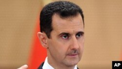 In this Monday, June 20, 2011 file photo released by the Syrian official news agency SANA, Syrian President Bashar Assad delivers a speech in Damascus, Syria, at Damascus University. In his first interview in six months, Syrian President Bashar Assad insi