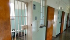 Nelson Mandela's former prison cell on Robben Island, South Africa, Dec. 14, 2013. Henry Ridgwell for VOA.
