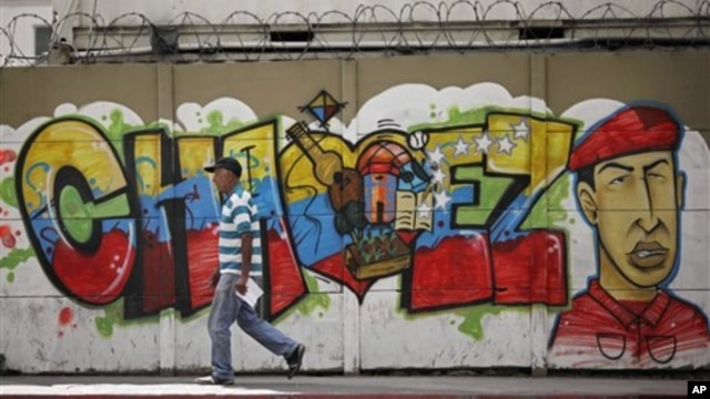 A man walks past a mural of Venezuela's President Hugo Chavez in Caracas, Jan. 2, 2013.