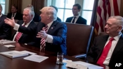 President Donald Trump, flanked by Secretary of State Rex Tillerson, left, and Defense Secretary Jim Mattis, speaks during a meeting, June 12, 2017, in the Cabinet Room of the White House in Washington. The Trump administration has recently been reviewing its strategy toward South Asia.