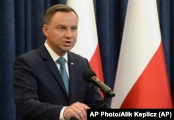 FILE - Polish President Andrzej Duda makes a statement in Warsaw, Poland, July 24, 2017.