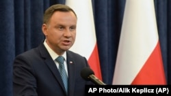 Polish President Andrzej Duda makes a statement in Warsaw, Poland, Monday, July 24, 2017. Duda said he would block two of three laws passed by the legislature that aimed at changing the judicial system. (AP Photo/Alik Keplicz)