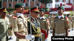 General Sher Mohammad Karimi, Afghan Army Chief of General Staff who was chief guest at passing out parade at Pakistan Military Academy, Kakul reviewing the parade, April 18, 2015.