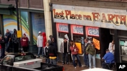 People looking to purchase designer drugs line up in front of the Last Place On Earth store in Duluth, Minnesota, in this September 21, 2011, file photo.