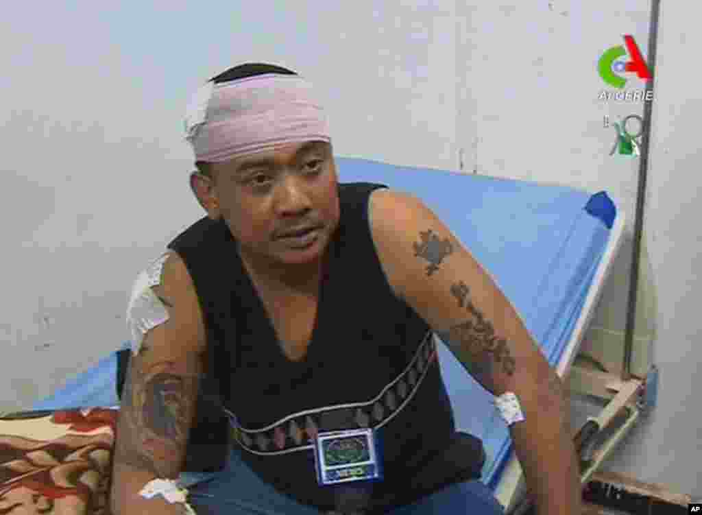 An unidentified former hostage speaks to the media in a hospital in Ain Amenas, Algeria, in this image taken from television, January 18, 2013. (Canal Algerie)