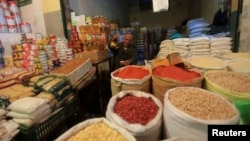 A man sells beans and spices in the old market in Benghazi