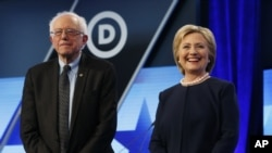 FILE - Democratic presidential candidates Hillary Clinton and Bernie Sanders stand together before the start of the Univision-Washington Post Democratic presidential debate at Miami-Dade College, March 9, 2016.