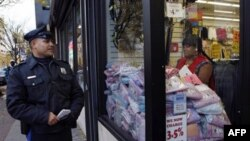"Officer L.A. Sanchez walks a beat in a downtown shopping area in Camden, New Jersey, in November 2010. ""The Camden Police Department will not abandon its community policing philosophy,"" said Chief Scott Thomson, even as the department and other city agenc"