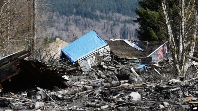 A house is seen destroyed by mud on Highway 530 next to mile marker 37, in Washington state, March 23, 2014.