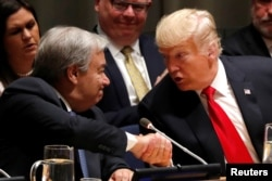 """U.S. President Donald Trump greets UN Secretary-General Antonio Guterres during the """"Global Call to Action on the World Drug Problem"""" event at the United Nations in New York, Sept. 24, 2018."""