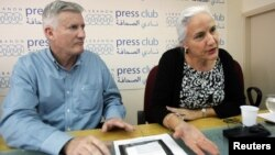 Debra, right, and Marc Tice, parents of Austin Tice, a journalist who has been missing in Syria since August this year, answer questions from journalists at the Press Club in Beirut, November 12, 2012.