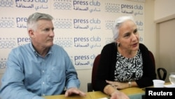 FILE - Debra, right, and Marc Tice, parents of Austin Tice, a journalist who has been missing in Syria since August this year, answer questions from journalists at the Press Club in Beirut, Nov. 12, 2012.