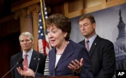 FILE - Sen. Susan Collins, R-Maine, center, flanked by Sen. Dean Heller, R-Nev., right, and Sen. Rob Portman, R-Ohio, left, on Capitol Hill, Washington.