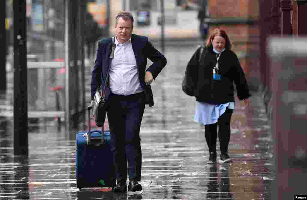 Britain's chief Brexit negotiator David Frost arrives at St. Pancras International station in London.