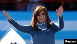FILE - Former Argentine President Cristina Fernandez de Kirchner waves during a rally in Buenos Aires, June 20, 2017.
