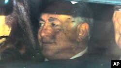 Dominique Strauss-Kahn arrives at the Lille courthouse in Lille, northern Franceo testify in a trial involving orgies and an alleged prostitution ring, Feb. 10, 2015.