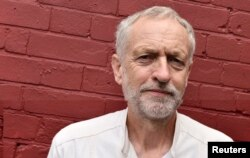 FILE - British Labor Party politician Jeremy Corbyn poses for a portrait outside of a community meeting in north London, Aug. 9, 2015.