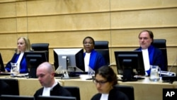 Judges Sylvia Steiner, Sanji Mmasenono Monageng, and Cuno Tarfusser, back row, from left, are seen in the courtroom in The Hague, Netherlands. The International Criminal Court (ICC) has issued arrest warrants for Libyan leader Moammar Gadhafi, his son and