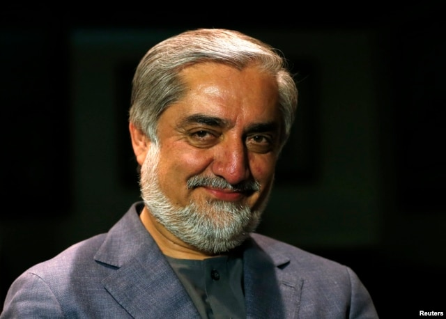 Afghan presidential candidate Abdullah Abdullah smiles during an interview in Kabul, Apr. 19, 2014.