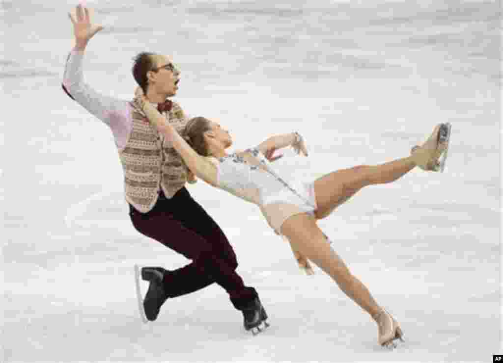 Nelli Zhiganshina and Alexander Gazsi of Germany compete in the ice dance short dance figure skating competition at the Iceberg Skating Palace during the 2014 Winter Olympics, Sunday, Feb. 16, 2014, in Sochi, Russia. (AP Photo/Bernat Armangue)