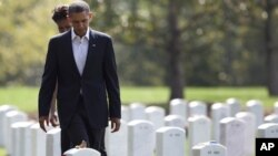 President Barack Obama and first lady Michelle Obama, visit Section 60 at Arlington National Cemetery, Saturday, Sept. 10, 2011, in Arlington, Va., to pay their respects to those who have made the ultimate sacrifice in the past decade.