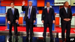 FILE - Republican presidential candidates, Sen. Marco Rubio, businessman Donald Trump, Sen. Ted Cruz, and Ohio Gov. John Kasich take the stage before a Republican presidential primary debate at Fox Theatre in Detroit, March 3, 2016.