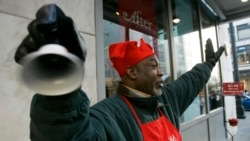 Salvation Army, in red aprons ringing bells