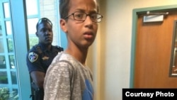 Ahmed Mohamed is seen in handcuffs after a clock he made was mistaken for a bomb.