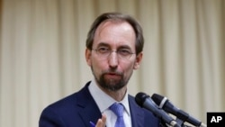 FILE - U.N. High Commissioner for Human Rights Zeid Ra'ad Al Hussein answers questions during a press conference.