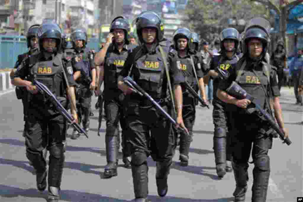 Bangladeshi security personnel patrol in front of Baitul Mukarram mosque in Dhaka, Bangladesh, Friday, March 1, 2013. Protesters clashed with police for a second day Friday as the death toll rose to at least 44 in clashes triggered by a death sentence given to Delwar Hossain Sayedee.