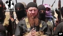 FILE - Islamic State commander Omar al-Shishani (C), aka Omar the Chechen, is seen in an image made from undated video posted June 28, 2014, on a social media account frequently used for communications by the jihadist group.