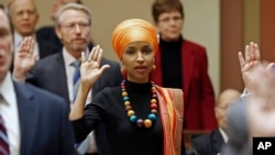 State Rep. Ilhan Omar takes the oath of office as the 2017 Legislature convened Tuesday, Jan. 3, 2017, in St. Paul, Minn.