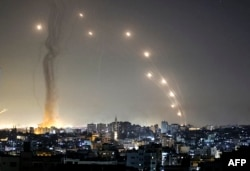 Rockets are launched towards Israel from Gaza City, controlled by the Palestinian Hamas movement, on May 11, 2021. (Photo by MAHMUD HAMS / AFP)