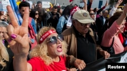 Tunisian demonstrators shout during a protest seeking equality between men and women in Tunis, Tunisia, March 10, 2018.