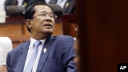 Cambodia's Prime Minister Hun Sen waits in the hall of National Assembly before a meeting, in Phnom Penh, Cambodia, Monday, Feb. 20, 2017. (AP Photo/Heng Sinith)