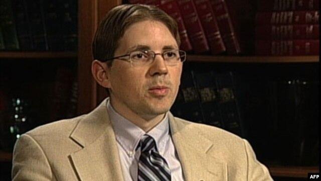 Analitičar Džon Vertman
