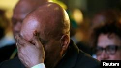 Le président sud-africain Jacob Zuma réagit à l'annonce officielle des résultats de l'élection municipale à Pretoria, Afrique du sud, le 6 août 2016.