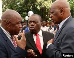 FILE: Zimbabwean President Emmerson Mnangagwa's advisor Chris Mutsvangwa talks to Foreign Affairs minister Sibusiso Moyo and Finance Minister Patrick Chinamasa at State House in Harare, Zimbabwe Dec. 4, 2017.