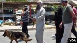 Ahmad Assir walks his dog with family members and bodyguards in Sidon July 5, 2012 (VOA/Jeff Neumann).