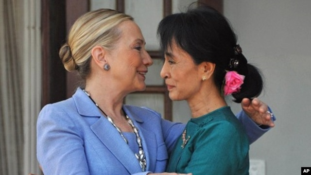 Burmese democracy leader Aung San Suu Kyi (R) greets visiting US Secretary of State Hillary Clinton following their meeting at Suu Kyi's residence in Rangoon, December 2, 2011.