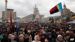 Pro-European Union activists attend a rally in Independence Square in Kiev, Ukraine, Sunday, Jan. 12, 2014. Tens of thousands of activists rallied in the center of the Ukrainian capital on Sunday, while the organizers of the weeks-long anti-government pro