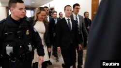 Facebook CEO Mark Zuckerberg walks to a meeting with Senator John Thune (R-SD) on Capitol Hill in Washington, April 9, 2018.