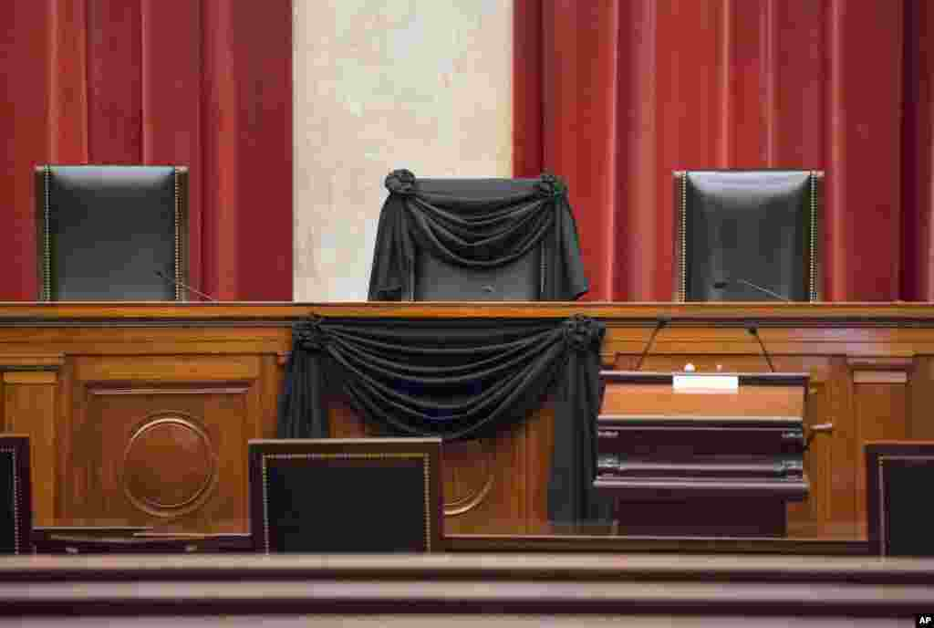 Supreme Court Justice Antonin Scalia's courtroom chair is draped in black to mark his death as part of a tradition that dates to the 19th century, at the Supreme Court in Washington, D.C. Scalia died at age 79. He joined the court in 1986 and was its longest-serving justice.