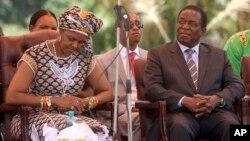FILE - Zimbabwean first lady Grace Mugabe (L) sits next to vice President Emmerson Mnangagwa at the Zanu pf headquarters in Harare, Feb, 10, 2016.